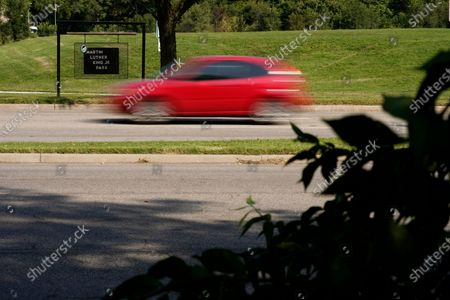 Car passes Martin Luther King Jr. park adjacent to Swope Parkway, in Kansas City, Mo. The stretch of road, along with parts of two other streets, would be renamed to honor King under a city proposal coming in the wake of failed effort to honor King last year