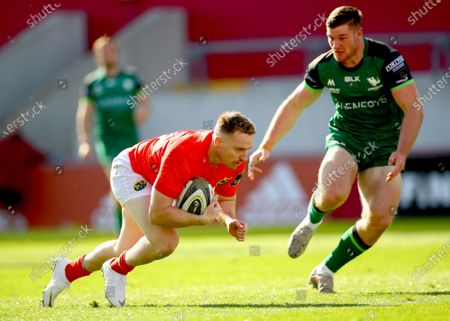 Munster A vs Connacht Eagles. Munster's Rory Scannell scores a try despite Peter Sullivan of Connacht