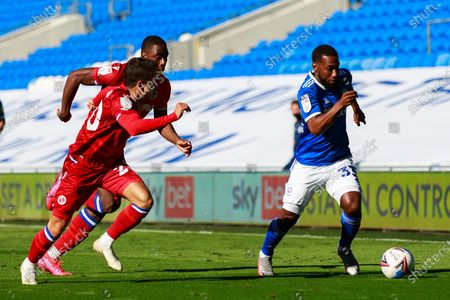 Cardiff City midfielder Junior Hoilett (33) is chased by Reading midfielder Felipe Araruna Hoffmann (20) during the EFL Sky Bet Championship match between Cardiff City and Reading at the Cardiff City Stadium, Cardiff