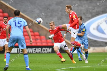 Barnsley FC player Cauley Woodrow (9) and Barnsley FC player Luke Thomas (16) during the EFL Sky Bet Championship match between Barnsley and Coventry City at Oakwell, Barnsley