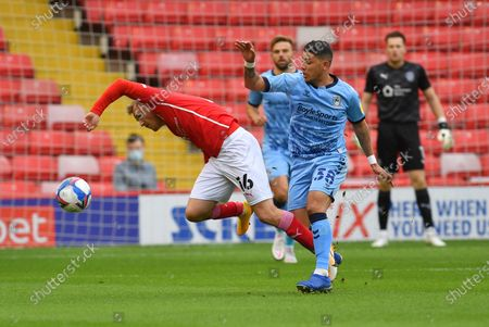 Barnsley FC player Luke Thomas (16) and Coventry City midfielder Gustavo Hamer (38) during the EFL Sky Bet Championship match between Barnsley and Coventry City at Oakwell, Barnsley