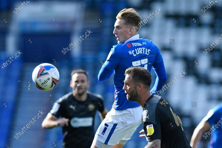 Ronan Curtis of Portsmouth vies for the ball with Lee Evans of Wigan Athletic during Portsmouth vs Wigan Athletic, Sky Bet EFL League 1 Football at Fratton Park on 26th September 2020
