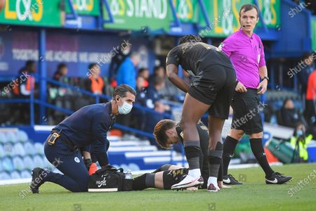 Injury concern for Tom Pearce of Wigan Athletic during Portsmouth vs Wigan Athletic, Sky Bet EFL League 1 Football at Fratton Park on 26th September 2020