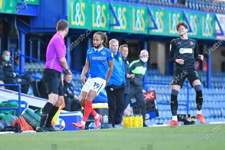 Tom Pearce of Wigan Athletic right pulls up after a previous injury and has to go off during Portsmouth vs Wigan Athletic, Sky Bet EFL League 1 Football at Fratton Park on 26th September 2020