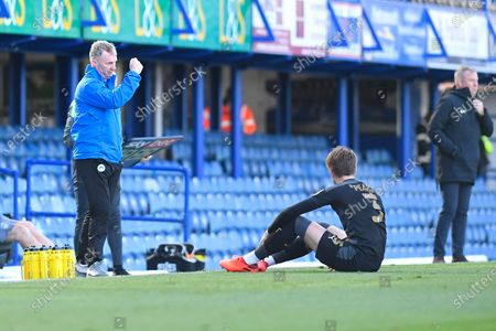 Wigan Athletic ManagerÊJohn Sheridan makes arrangements to substitute injured Tom Pearce of Wigan Athletic right during Portsmouth vs Wigan Athletic, Sky Bet EFL League 1 Football at Fratton Park on 26th September 2020