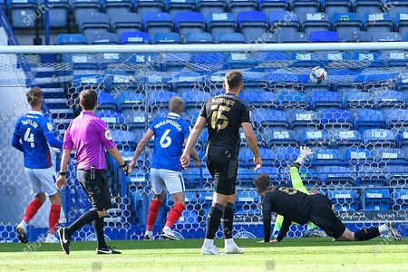 Lee Evans of Wigan Athletic on floor scores the first goal during Portsmouth vs Wigan Athletic, Sky Bet EFL League 1 Football at Fratton Park on 26th September 2020