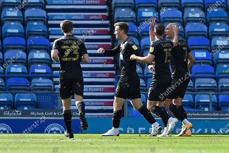 Lee Evans of Wigan Athletic middle celebrates scoring the first goal during Portsmouth vs Wigan Athletic, Sky Bet EFL League 1 Football at Fratton Park on 26th September 2020