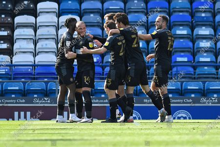 Wigan Athletic players celebrate the first goal scored by Lee Evans of Wigan Athletic during Portsmouth vs Wigan Athletic, Sky Bet EFL League 1 Football at Fratton Park on 26th September 2020