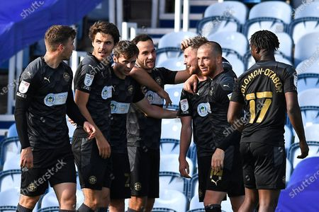 Tom James of Wigan Athletic middle is congratulated after scoring the second goal during Portsmouth vs Wigan Athletic, Sky Bet EFL League 1 Football at Fratton Park on 26th September 2020