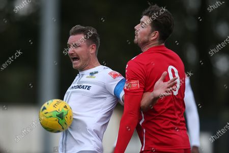 Stock Photo of David Winfield of Romford and George Sykes of Aveley during Romford vs Aveley, Pitching In Ishmian League North Division Football at Mayesbrook Park on 26th September 2020