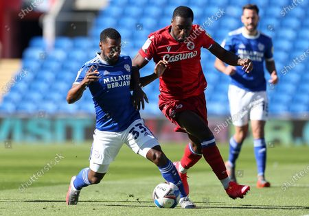 Junior Hoilett of Cardiff City is challenged by Yakou Meite of Reading.