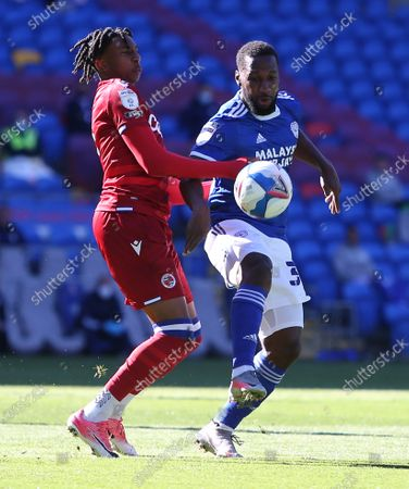 Junior Hoilett of Cardiff City is challenged by Ovie Ejaria of Reading.
