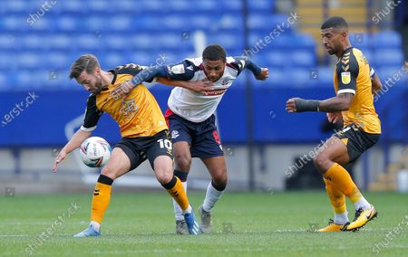 Josh Sheehan of Newport County struggles with Brandon Comley of Bolton Wanderers