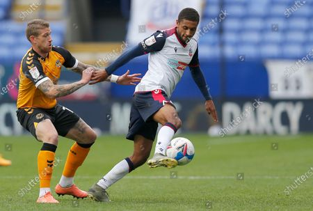 Scot Bennett of Newport County tangles with Brandon Comley of Bolton Wanderers