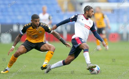 Joss Labadie of Newport County chases Brandon Comley of Bolton Wanderers