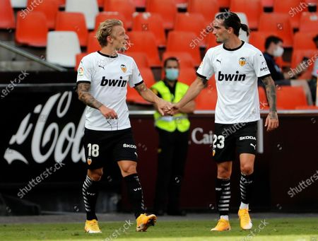 "Valencia' midfielder Daniel Wass (L) celebrates with teammates David Remeseiro ""Jason"" after scoring the 1-0 goal during their Spanish LaLiga soccer match held at Mestalla Stadium in Valencia, Spain, 26 September 2020."