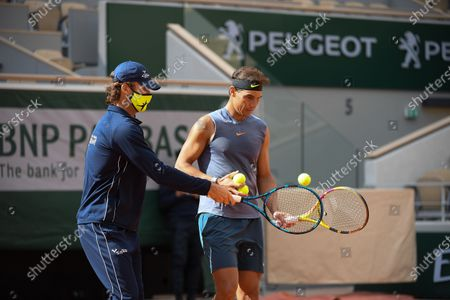 Stock Picture of Carlos Moya and Rafael Nadal during a training session at Roland Garros stadium