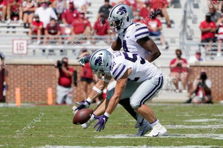 Kansas State linebacker Nick Allen (52) picks up a the ball on a blocked punt in front of teammate Wayne Jones (4) during the second half of an NCAA college football game against Oklahoma, in Norman, Okla
