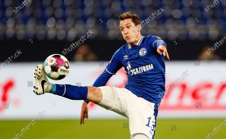 Schalke's Sebastian Rudy jumps for the ball during the German Bundesliga soccer match between FC Schalke 04 and Werder Bremen in Gelsenkirchen, Germany