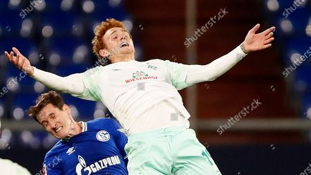 Bremen's Josh Sargent, up, and Schalke's Sebastian Rudy, challenge during the German Bundesliga soccer match between FC Schalke 04 and Werder Bremen in Gelsenkirchen, Germany