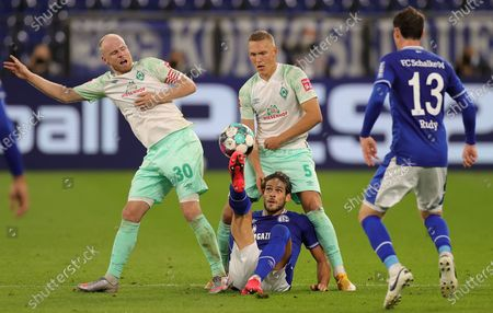 Bremen's Davy Klaassen (L) and Bremen's Kevin Moehwald (2-L) in action against Schalke's Goncalo Paciencia (2-L) and Schalke's Sebastian Rudy (R) during the German Bundesliga soccer match between Schalke 04 and SV Werder Bremen in Gelsenkirchen, Germany, 26 September 2020.