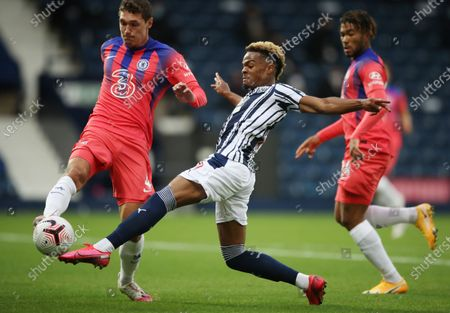 Grady Diangana of West Bromwich (C) in action against Andreas Christensen of Chelsea (L) during the English Premier League match between West Bromwich Albion and Chelsea in West Bromwich, Britain, 26 September 2020.