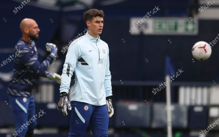 Chelsea's Goalkeepers Kepa Arrizabalaga right and Willy Caballero of Chelsea warm up before the English Premier League soccer match between West Bromwich Albion and Chelsea at the Hawthorns in West Bromwich, England