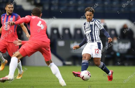 West Bromwich Albion's Matheus Pereira, right, and Chelsea's Andreas Chistensen challenge for the ball during the English Premier League soccer match between West Bromwich Albion and Chelsea at the Hawthorns in West Bromwich, England