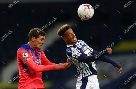 West Bromwich Albion's Callum Robinson, right, and Chelsea's Andreas Christensen head the ball during the English Premier League soccer match between West Bromwich Albion and Chelsea at the Hawthorns in West Bromwich, England