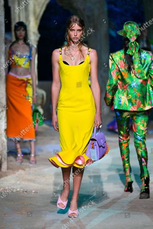 Stock Image of Abby Champion wearing an outfit from the women s ready to wear collections, spring summer 2021, original creation, during the Womenswear Fashion Week in Milan, from the house of Versace