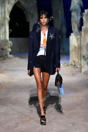 Mica Arganaraz wearing an outfit from the women s ready to wear collections, spring summer 2021, original creation, during the Womenswear Fashion Week in Milan, from the house of Versace
