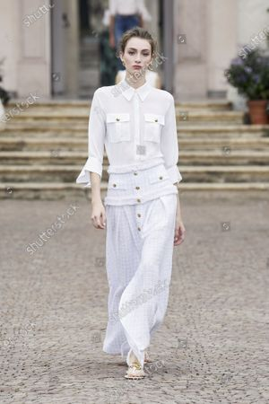 Stock Photo of A Model wearing an outfit from the women s ready to wear collections, spring summer 2021, original creation, during the Womenswear Fashion Week in Milan, from the house of Elisabetta Franchi