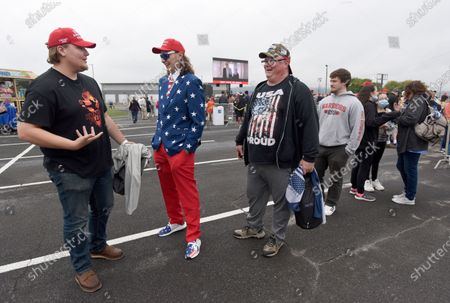 Stock Photo of From left, Will Lebo, of Newport, Pa., Andrew Wright, 19, of Newport, Pa., and Rob Schultz, of Woodbridge, Va., chat before a campaign rally for President Donald Trump, at Harrisburg International Airport, in Middletown, Pa