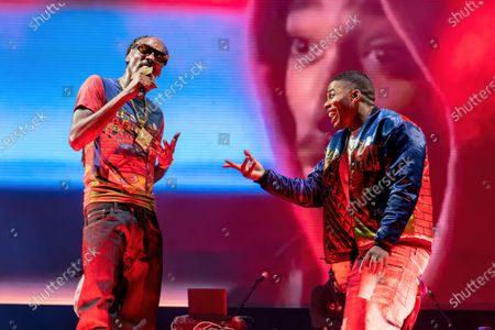 Snoop Dogg and Nelly perform a tribute to Tupac Shakur at the Hometown Heroes Music Festival at the Brushy Creek Amphitheater