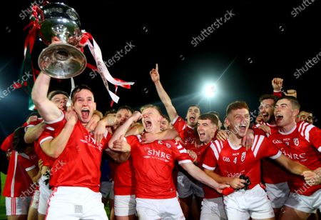 East Kerry vs Mid Kerry. The East Kerry team celebrate as captain Dan O'Donoghue holds the trophy