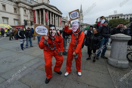 Demonstrators dressed as Chancellor of the Exchequer Rishi Sunak and Bill Gates in prison uniforms take part in Unite for Freedom rally in Trafalgar Square to protest against the restrictions imposed by the Government to control the spread of coronavirus, lockdowns, wearing face masks and vaccines. The protesters urged MPs to abolish the Coronavirus Act 2020, which is due to be reviewed in Parliament next week.