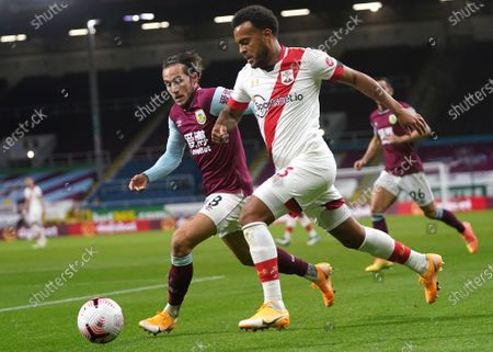 Josh Brownhill (L) of Burnley in action against Ryan Bertrand (R) of Southampton during the English Premier League match between Burnley and Southampton in Burnley, Britain, 26 September 2020.