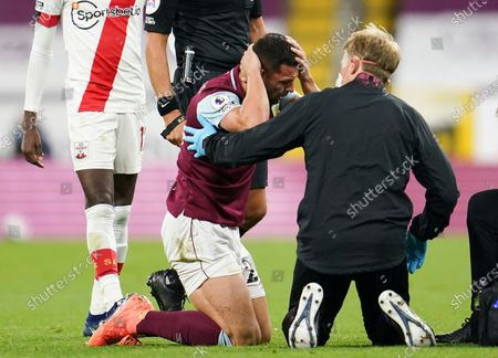 Burnley's Phil Bardsley receives medical treatment during the English Premier League soccer match between Burnley and Southampton at Turf Moor in Burnley, England