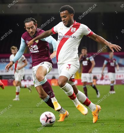 Southampton's Ryan Bertrand, right, and Burnley's Josh Brownhill battle for the ball during the English Premier League soccer match between Burnley and Southampton at Turf Moor in Burnley, England