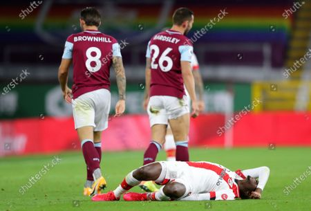 Southampton's Moussa Djenepo reacts after he was tackled by Burnley's Phil Bardsley, right, during the English Premier League soccer match between Burnley and Southampton at Turf Moor in Burnley, England