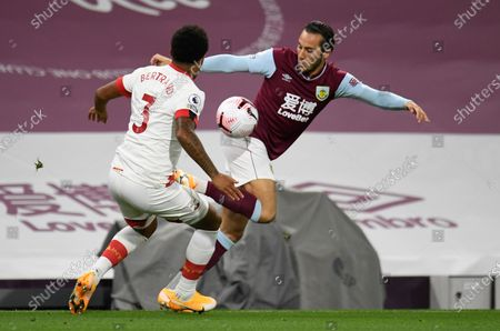 Southampton's Ryan Bertrand, left, and Burnley's Josh Brownhill battle for the ball during the English Premier League soccer match between Burnley and Southampton at Turf Moor in Burnley, England