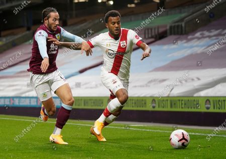 Burnley's Josh Brownhill, left, and Southampton's Ryan Bertrand battle for the ball during the English Premier League soccer match between Burnley and Southampton at Turf Moor in Burnley, England