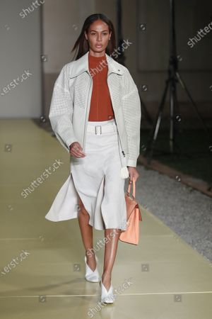 Stock Image of Model Joan Smalls wears a creation as part of the Salvatore Ferragamo 2021 women's spring-summer ready-to-wear collection during the fashion week in Milan, Italy