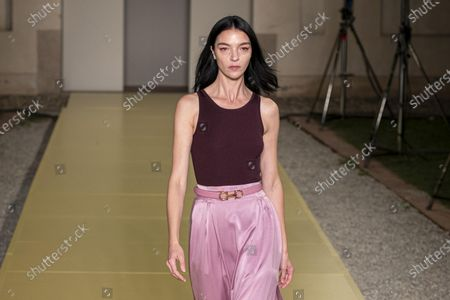 Stock Image of Maria Carla Boscono presents a creation by Salvatore Ferragamo during the Women's and Men's Spring/Summer 2021 collections in Milan, Italy, 26 September 2020.