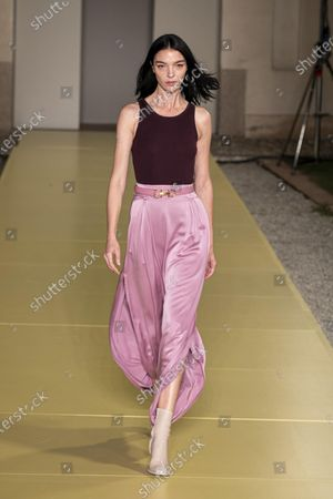 Maria Carla Boscono presents a creation by Salvatore Ferragamo during the Women's and Men's Spring/Summer 2021 collections in Milan, Italy, 26 September 2020.