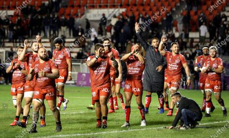 RC Toulon vs Leicester Tigers. Toulon's Beka Gigashvili celebrates after the game with Anthony Etrillard and Gabin Villiere