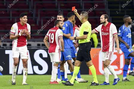 Edson Alvarez (L) of Ajax receives the red card from referee Pol van Boekel during the Dutch Eredivisie soccer match between Ajax Amsterdam and Vitesse Arnhem at the Johan Cruijff Arena in Amsterdam, The Netherlands, 26 September 2020.