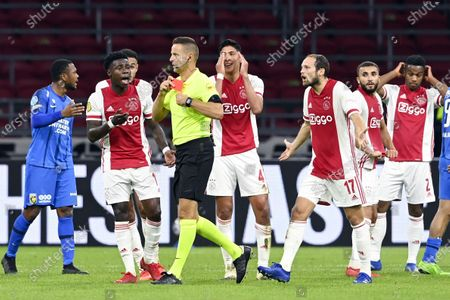 Edson Alvarez (5-L) of Ajax reacts after being sent off by referee Pol van Boekel (4-L) during the Dutch Eredivisie soccer match between Ajax Amsterdam and Vitesse Arnhem at the Johan Cruijff Arena in Amsterdam, The Netherlands, 26 September 2020.