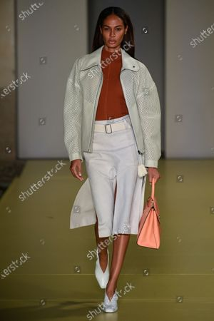 Joan Smalls on the catwalk wearing an outfit from the women s ready to wear collections, spring summer 2021, original creation, during the Womenswear Fashion Week in Milan, from the house of Salvatore Ferragamo