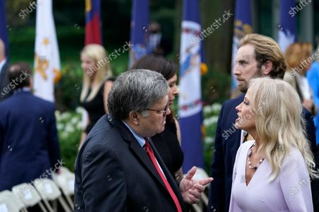Attorney General William Barr speaks with Kellyanne Conway after President Donald Trump announced Judge Amy Coney Barrett as his nominee to the Supreme Court, in the Rose Garden at the White House, in Washington